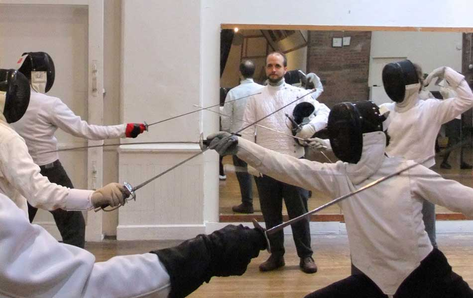 Jared teaching a Fencing Class